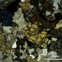 Quartz-microcline-diopsite gneiss-thin section cross polarized light